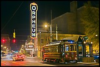 Street by night with trolley and Orpheum theater. Memphis, Tennessee, USA