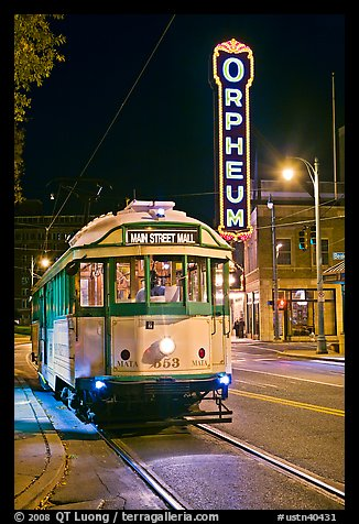 Trolley and Orpheum theater sign by night. Memphis, Tennessee, USA (color)