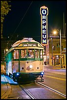 Trolley and Orpheum theater sign by night. Memphis, Tennessee, USA