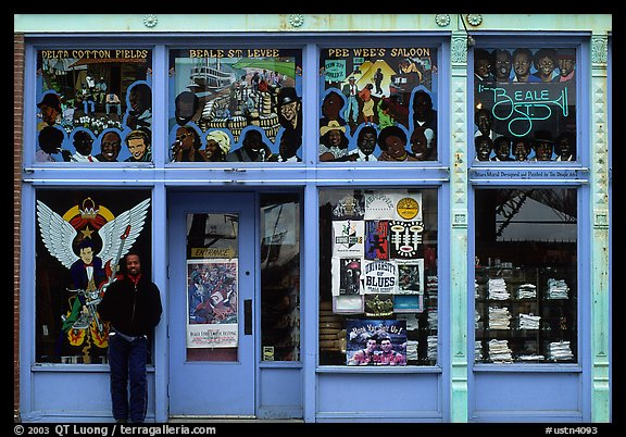 African-American man standing in front of blue storefront on Beal street. Memphis, Tennessee, USA (color)