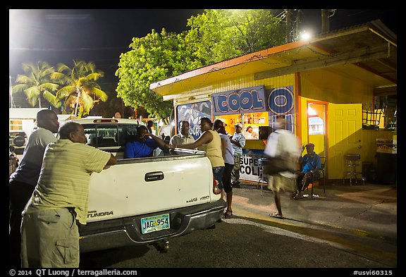 Pick-up truck and bar at night, Cruz Bay. Saint John, US Virgin Islands (color)