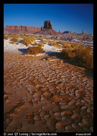 Clay pattern on floor and buttes in winter. Monument Valley Tribal Park, Navajo Nation, Arizona and Utah, USA (color)