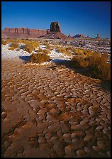 Clay pattern on floor and buttes in winter. Monument Valley Tribal Park, Navajo Nation, Arizona and Utah, USA ( color)