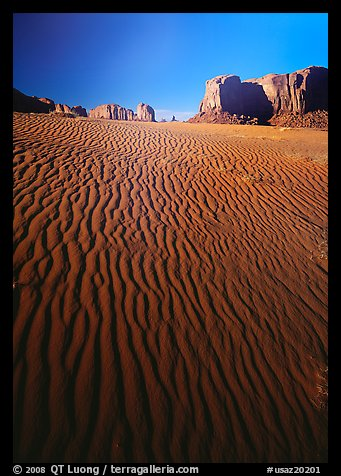 Ripples on sand dunes and mesas, late afternoon. Monument Valley Tribal Park, Navajo Nation, Arizona and Utah, USA (color)