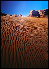 Ripples on sand dunes and mesas, late afternoon. Monument Valley Tribal Park, Navajo Nation, Arizona and Utah, USA ( color)