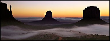 Monument Valley mittens at sunrise with fog. Monument Valley Tribal Park, Navajo Nation, Arizona and Utah, USA (Panoramic color)