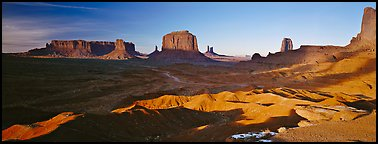 Monument Valley late afternoon scenery with shadows. Monument Valley Tribal Park, Navajo Nation, Arizona and Utah, USA (Panoramic color)