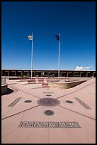 Disks, seals, and flags. Four Corners Monument, Arizona, USA ( color)