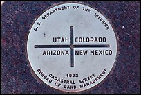 Marker at the exact Four Corners point. Four Corners Monument, Arizona, USA ( color)