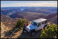 Jeep and visitors on rim edge of Grand Canyon. Parashant National Monument, Arizona, USA ( color)