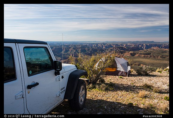 Jeep and tent on Canyon Rim, Twin Point. Parashant National Monument, Arizona, USA (color)