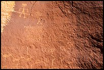 Petroglyph panel with anthropomorphic, zoomorphic, and abstract designs. Vermilion Cliffs National Monument, Arizona, USA ( color)