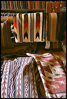 Stacks of varicolored blankets and rugs weaved by Navajo Indians. Hubbell Trading Post National Historical Site, Arizona, USA (color)