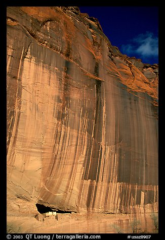 White House Ancestral Pueblan ruins and wall with desert varnish and corner of sky. Canyon de Chelly  National Monument, Arizona, USA (color)