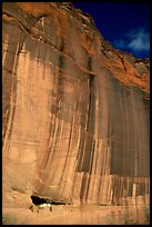 White House Ancestral Pueblan ruins and wall with desert varnish and corner of sky. Canyon de Chelly  National Monument, Arizona, USA