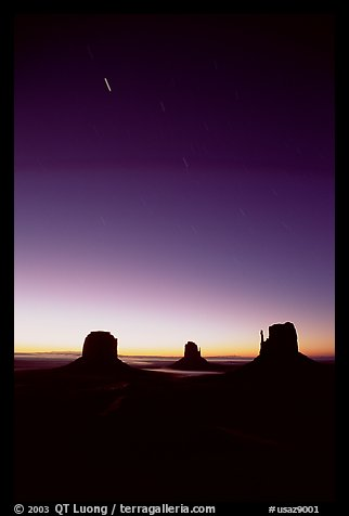 Buttes at dawn with short start trails. Monument Valley Tribal Park, Navajo Nation, Arizona and Utah, USA (color)