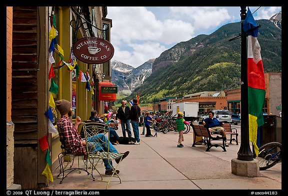 Men sitting on main street sidewalk. Telluride, Colorado, USA (color)