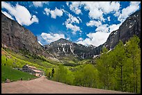 Road, aspens and Ajax peak in spring. Telluride, Colorado, USA