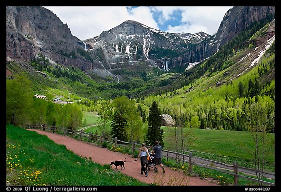Family hiking on trail towards Bridalveil Falls in the spring. Telluride, Colorado, USA (color)