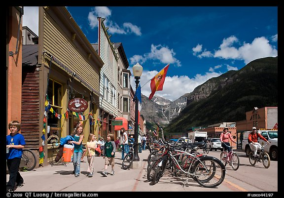 Children walking on main street past mountain bikes. Telluride, Colorado, USA (color)
