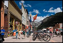 Children walking on main street past mountain bikes. Telluride, Colorado, USA ( color)