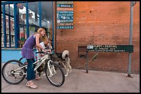 Girls on bikes and puppy parking. Telluride, Colorado, USA ( color)