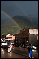 People watching double rainbow on main street. Telluride, Colorado, USA ( color)
