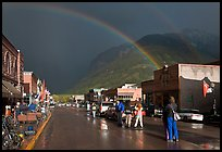 Double rainbow and dark sky over main street. Telluride, Colorado, USA ( color)