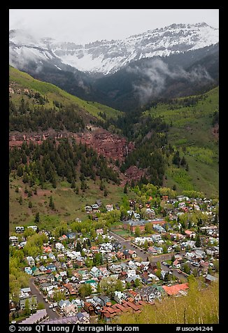 Town, waterfall, and snowy mountains in spring. Telluride, Colorado, USA (color)