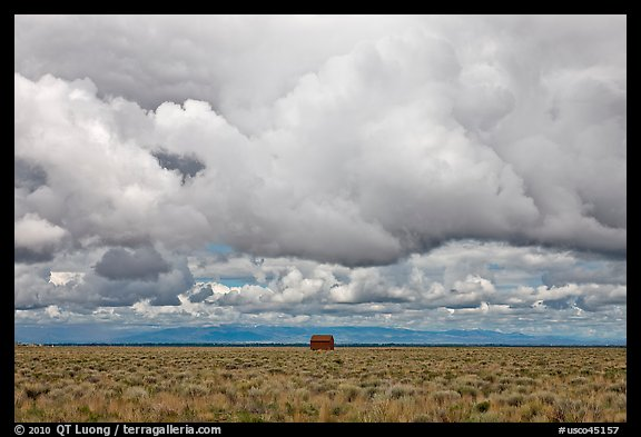 Lonely house on plain under clouds. Colorado, USA (color)