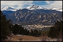 View of town nested below Rocky Mountains, Estes Park. Colorado, USA ( color)