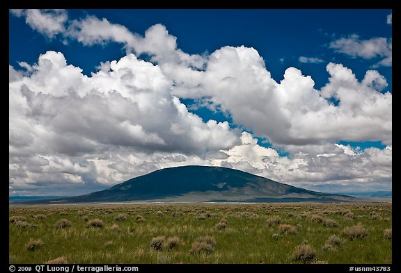 Volcanic hill and clouds. New Mexico, USA