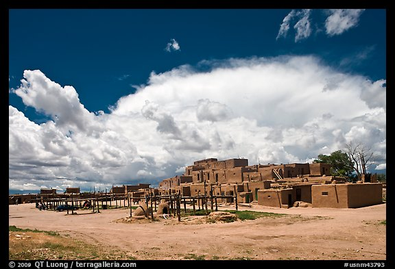 Afternoon cloud hovering over multi-family houses built by Pueblo Indians. Taos, New Mexico, USA (color)