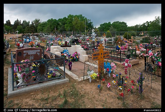 Cemetery with fenced graves. Taos, New Mexico, USA (color)