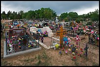 Cemetery with fenced graves. Taos, New Mexico, USA ( color)