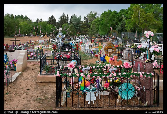 Graves with colorfull flowers. Taos, New Mexico, USA (color)