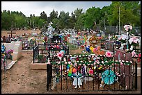 Graves with colorfull flowers. Taos, New Mexico, USA ( color)