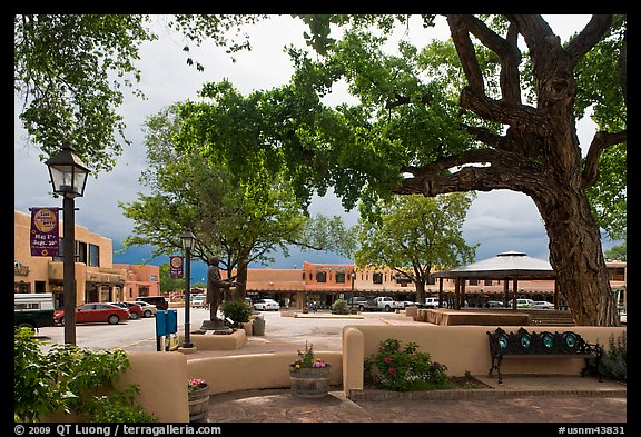 Plazza, trees and buildings in adobe style. Taos, New Mexico, USA (color)