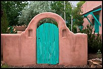 Blue door and adobe yard wall. Taos, New Mexico, USA (color)