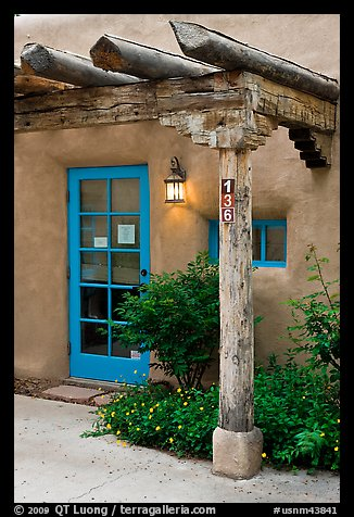 Blue door and window at house entrance. Taos, New Mexico, USA (color)