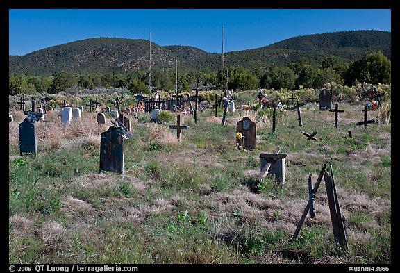 Headstones in grassy area, cemetery, Picuris Pueblo. New Mexico, USA (color)