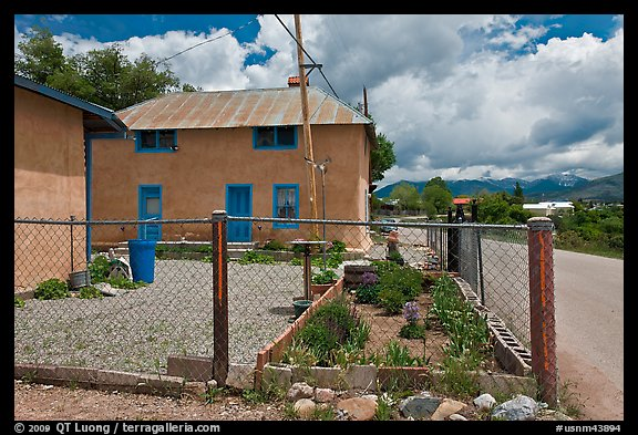 House with blue windows, Truchas. New Mexico, USA (color)
