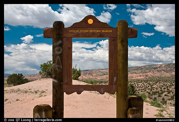 Historic marker framing high desert landscape. New Mexico, USA (color)