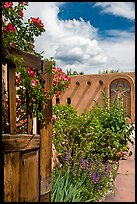 Gardens and adobe wall, Sanctuario de Chimayo. New Mexico, USA (color)