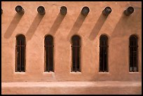 Facade with vigas (heavy timbers) extending through walls to support roof, Chimayo sanctuary. New Mexico, USA (color)