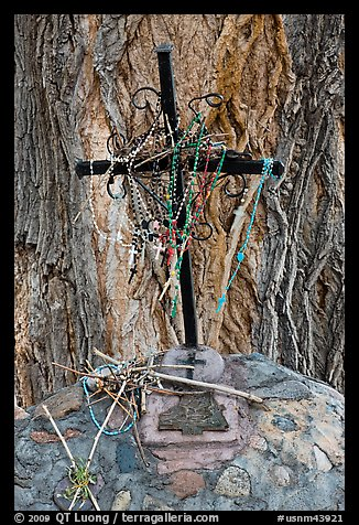 Metal cross festoned with rosaries, and crosses made of twigs, Sanctuario de Chimayo. New Mexico, USA (color)