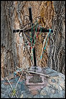 Metal cross festoned with rosaries, and crosses made of twigs, Sanctuario de Chimayo. New Mexico, USA