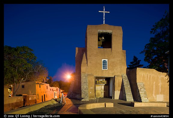 Oldest church and house in the US by night. Santa Fe, New Mexico, USA (color)
