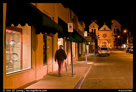 Man walking gallery and St Francis by night. Santa Fe, New Mexico, USA (color)