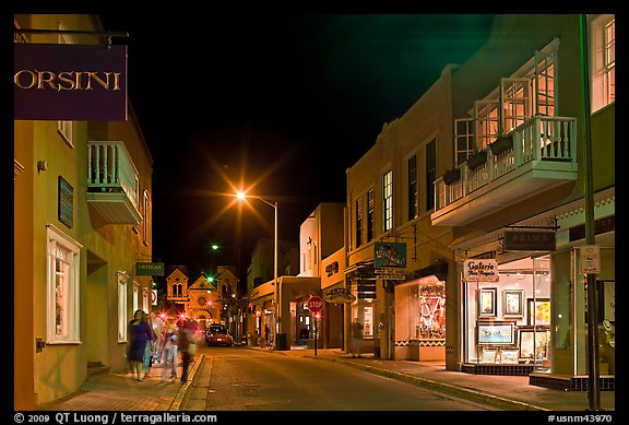Street with galleries, people walking, and cathedral by night. Santa Fe, New Mexico, USA (color)